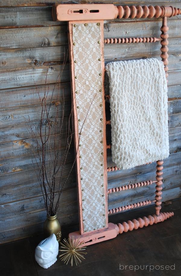 DIY Headboard Turned Quilt Rack